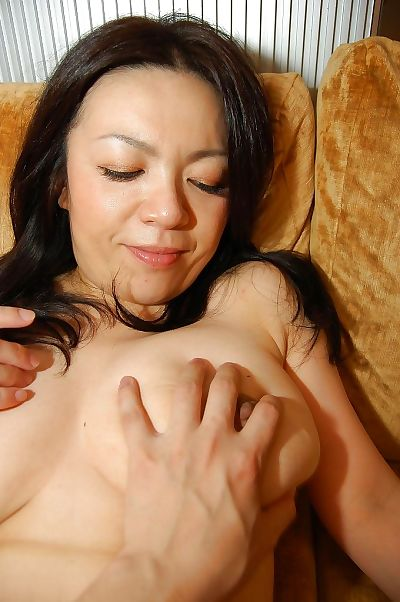 Horny asian MILF gets her..
