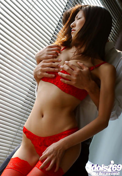 Bosomy asian babe in red..