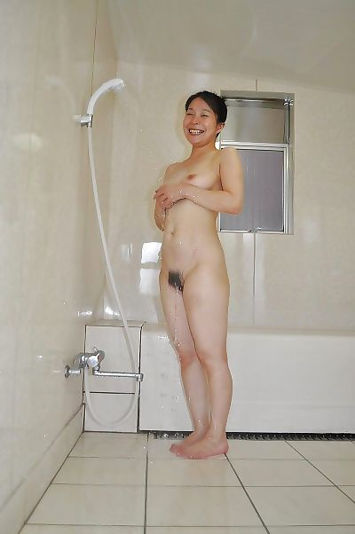 Smiley asian MILF with hairy..