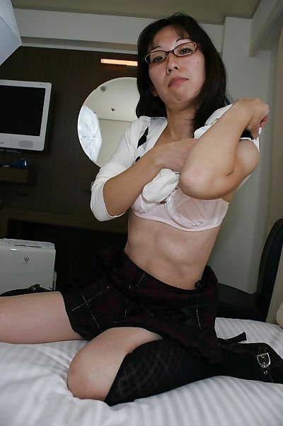 Skinny asian MILF in glasses..