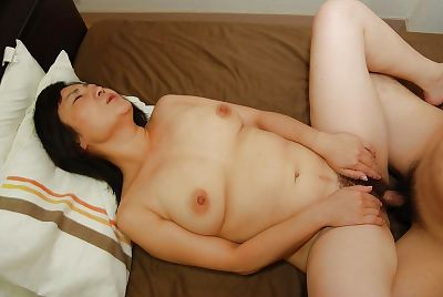 Naughty japanese MILF gives..