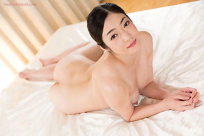 Sweet young Asian performs a..